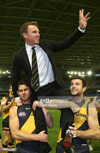 Nathan Foley of the Tigers is chaired off the ground during the round 23 AFL match between the Richmond Tigers and the North Melbourne Kangaroos at...
