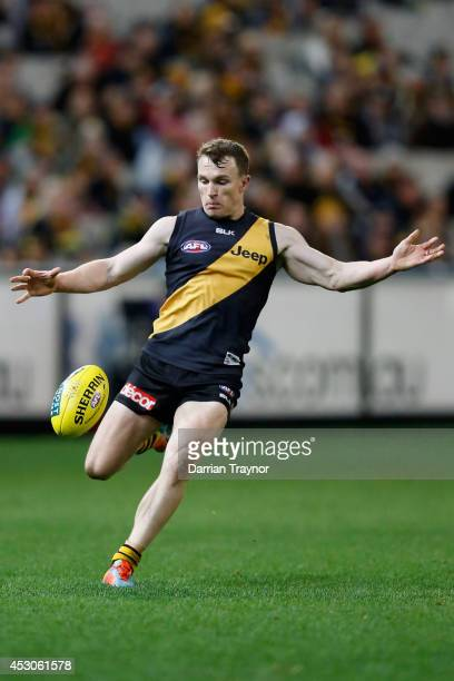 Nathan Foley of the Tigers kicks the ball during the round 19 AFL match between the Richmond Tigers and the Greater Western Sydney Giants at...