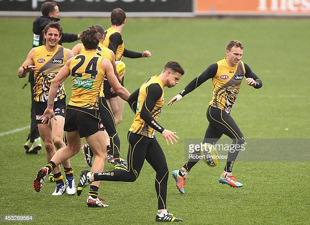 Nathan Foley runs with teammates during a Richmond Tigers AFL training session at ME Bank Centre on August 7 2014 in Melbourne Australia
