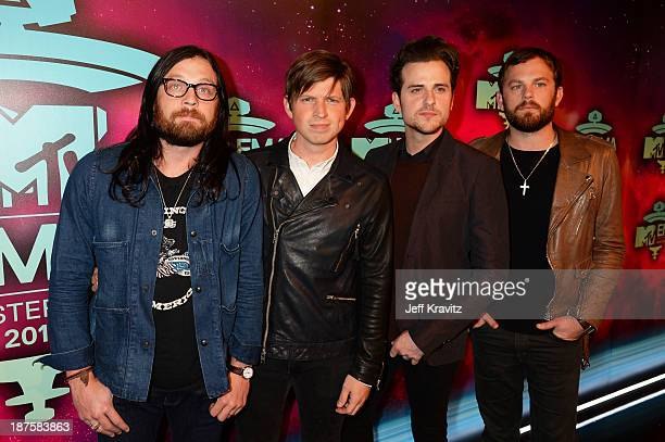 Nathan Followill Matthew Followill Jared Followill and Caleb Followill of Kings of Leon pose in the Exclusive Arrivals Studio during MTV EMA's 2013...