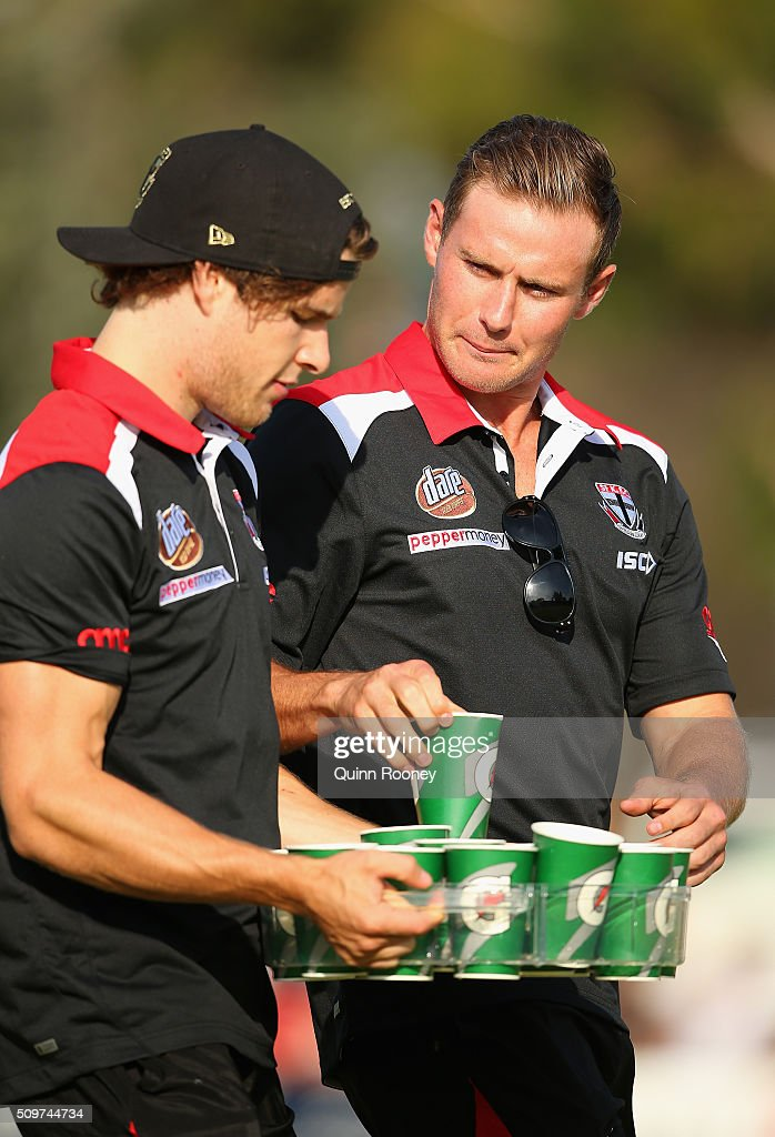 Nathan Freeman and David Armitage of the Saints carry the drinks during the quater time huddle during the St Kilda Saints AFL Intra-Club Match at Trevor Barker Beach Oval on February 12, 2016 in Melbourne, Australia.