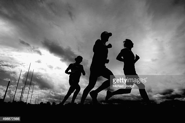 Nathan Freeman Dylan Roberton and Tom Hickey run laps with teammates during a St Kilda Saints AFL preseason training session at Linen House Oval on...