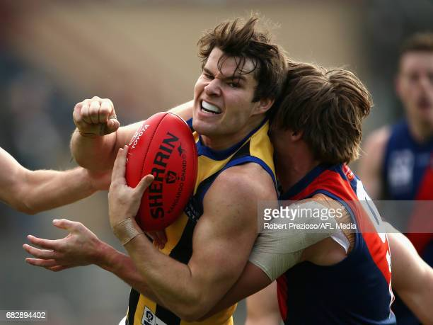 Nathan Freeman of Sandringham is tackled during the round five VFL match between Coburg and Sandringham at Pirhana Park on May 14 2017 in Melbourne...