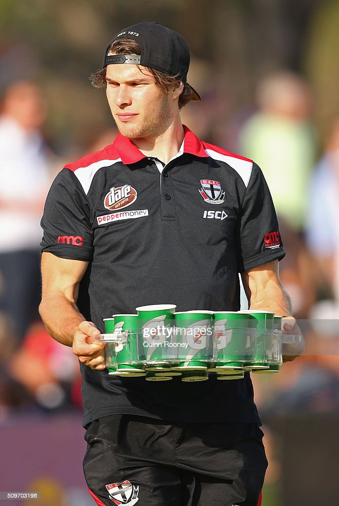 Nathan Freeman of the Saints carries the drinks during the quater time huddle during the St Kilda Saints AFL Intra-Club Match at Trevor Barker Beach Oval on February 12, 2016 in Melbourne, Australia.