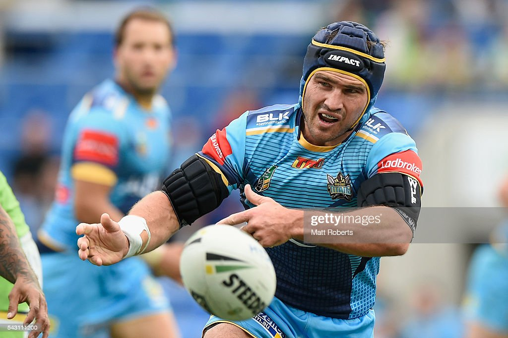 Nathan Friend of the Titans passes the ball during the round 16 NRL match between the Gold Coast Titans and the Canberra Raiders at Cbus Super Stadium on June 26, 2016 in Gold Coast, Australia.