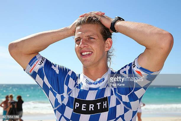 Nathan Fyfe looks on while talking to media after completing the Red Bull Lighthouse to Leighton kiteboard race on December 4 2016 in Perth Australia
