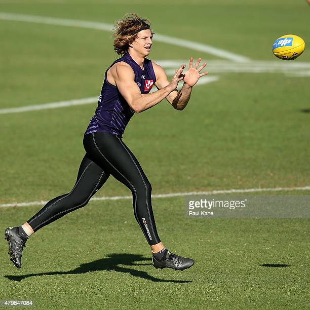 Nathan Fyfe marks the ball during a Fremantle Dockers AFL training session at Fremantle Oval on July 8 2015 in Fremantle Australia
