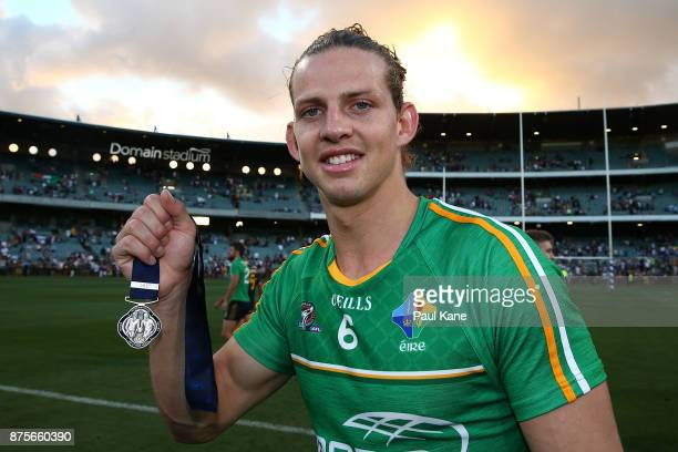 Nathan Fyfe of Australia poses with the player of the series medal after winning game two and the series of the International Rules Series between...