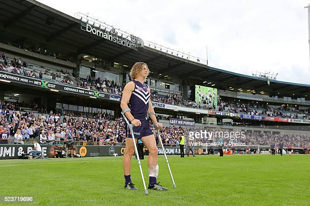 Nathan Fyfe of the Dockers can be seen on crutches after the round five AFL match between the Fremantle Dockers and the Carlton Blues at Domain...
