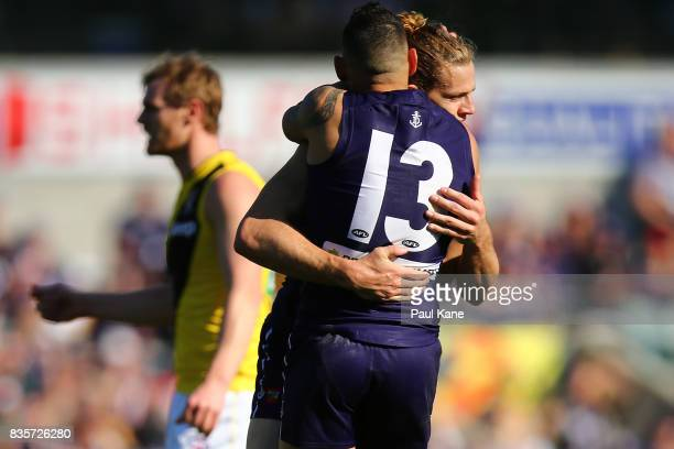 Nathan Fyfe of the Dockers celebrates a goal with Harley Bennell during the round 22 AFL match between the Fremantle Dockers and the Richmond Tigers...