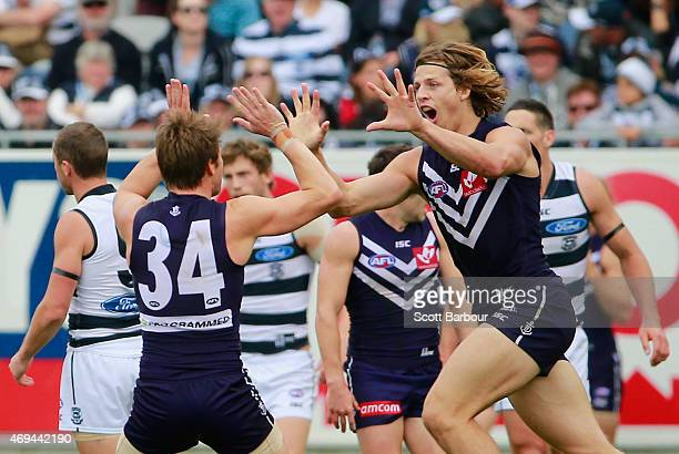 Nathan Fyfe of the Dockers celebrates with Lee Spurr after kicking a goal during the round two AFL match between the Geelong Cats and the Fremantle...
