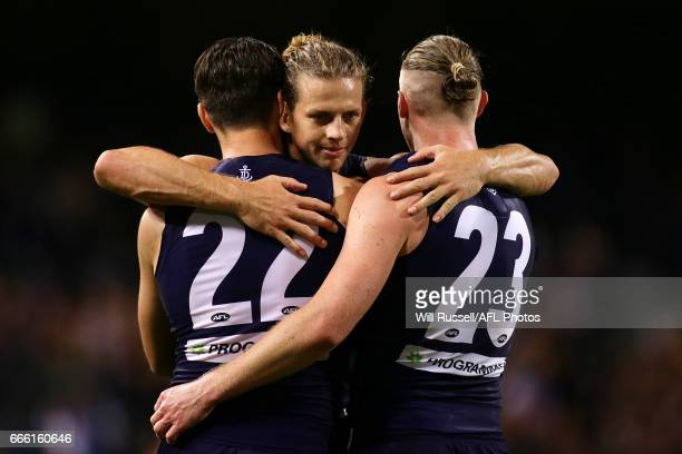 Nathan Fyfe of the Dockers celebrates with team mates after defeating the Bulldogsduring the round three AFL match between the Fremantle Dockers and...