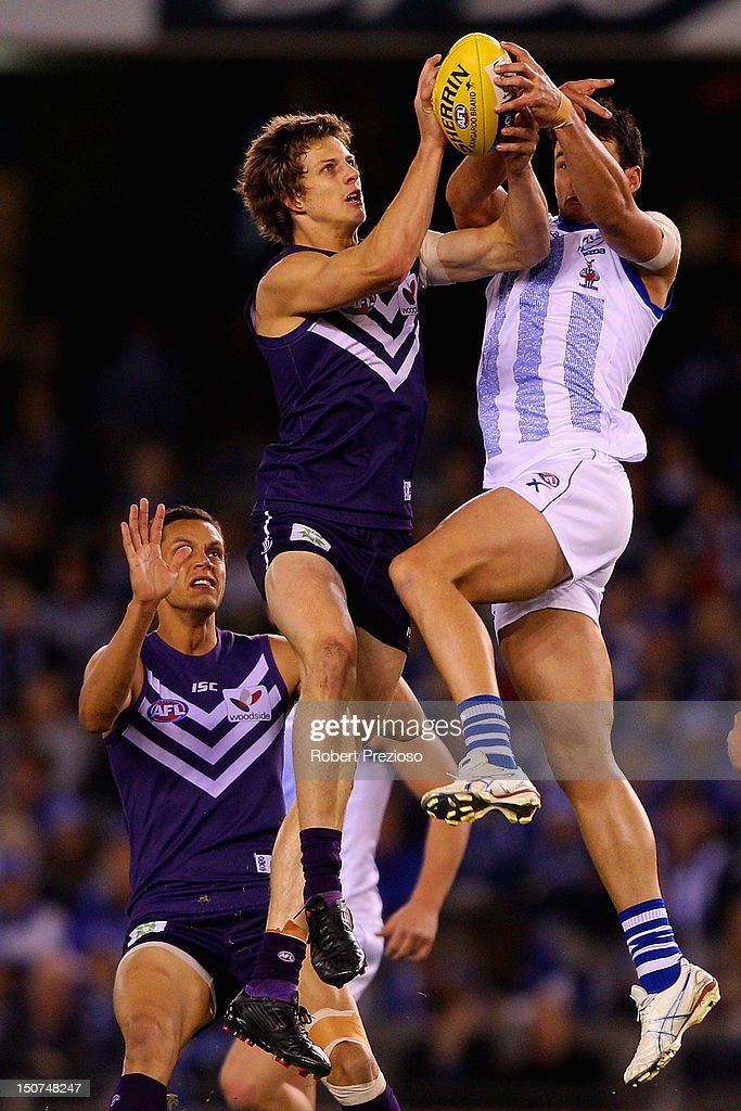 Nathan Fyfe of the Dockers flies for a mark during the round 22 AFL match between the North Melbourne Kangaroos and the Fremantle Dockers at Etihad Stadium on August 26, 2012 in Melbourne, Australia.