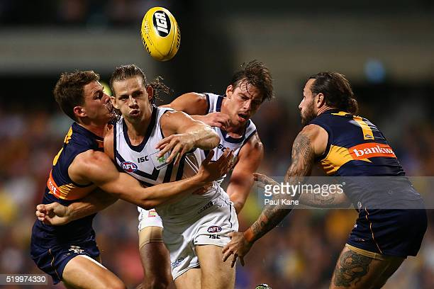 Nathan Fyfe of the Dockers gets his handball away while being tackled by Jack Redden of the Eagles during the round three AFL match between the West...
