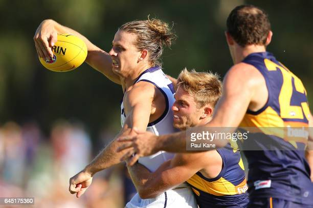 Nathan Fyfe of the Dockers gets tackled by Brad Sheppard of the Eagles during the JLT Community Series AFL match between the West Coast Eagles and...