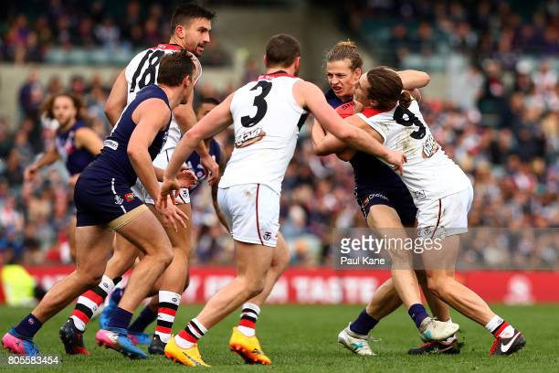 Nathan Fyfe of the Dockers gets tackled by Jack Steele of the Saints during the round 15 AFL match between the Fremantle Dockers and the St Kilda...