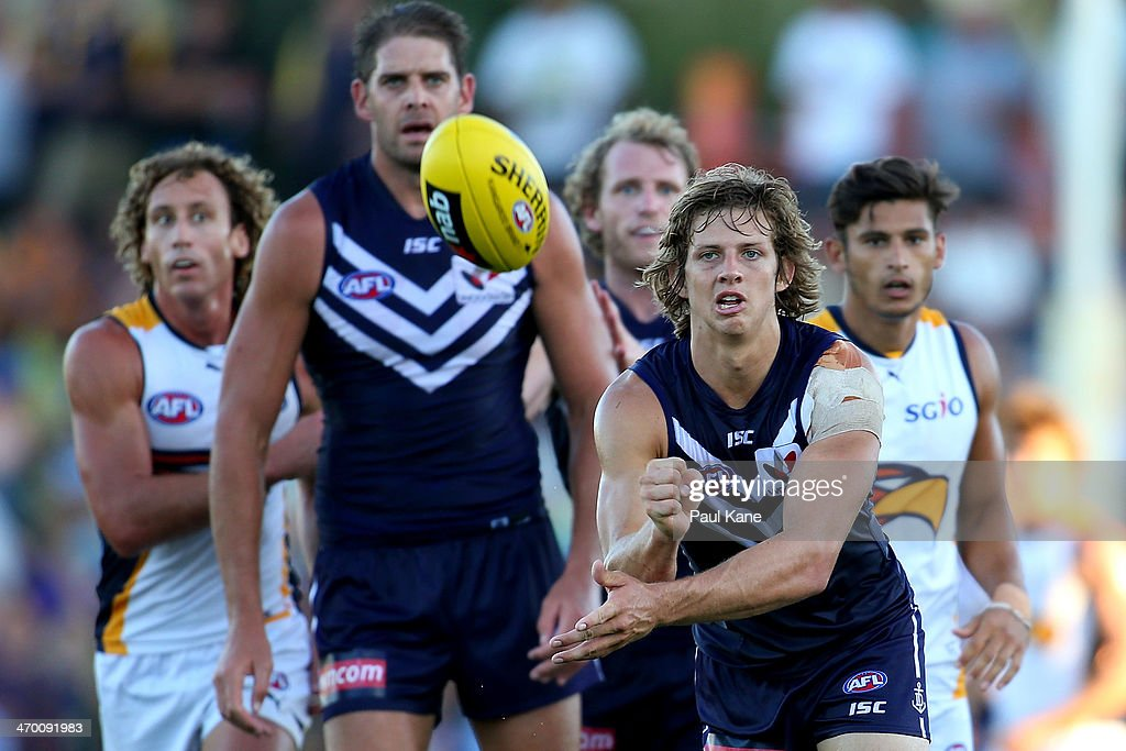 Nathan Fyfe of the Dockers handballs during the round two NAB Challenge Cup AFL match between the Fremantle Dockers and the West Coast Eagles at Arena Joondalup on February 18, 2014 in Perth, Australia.