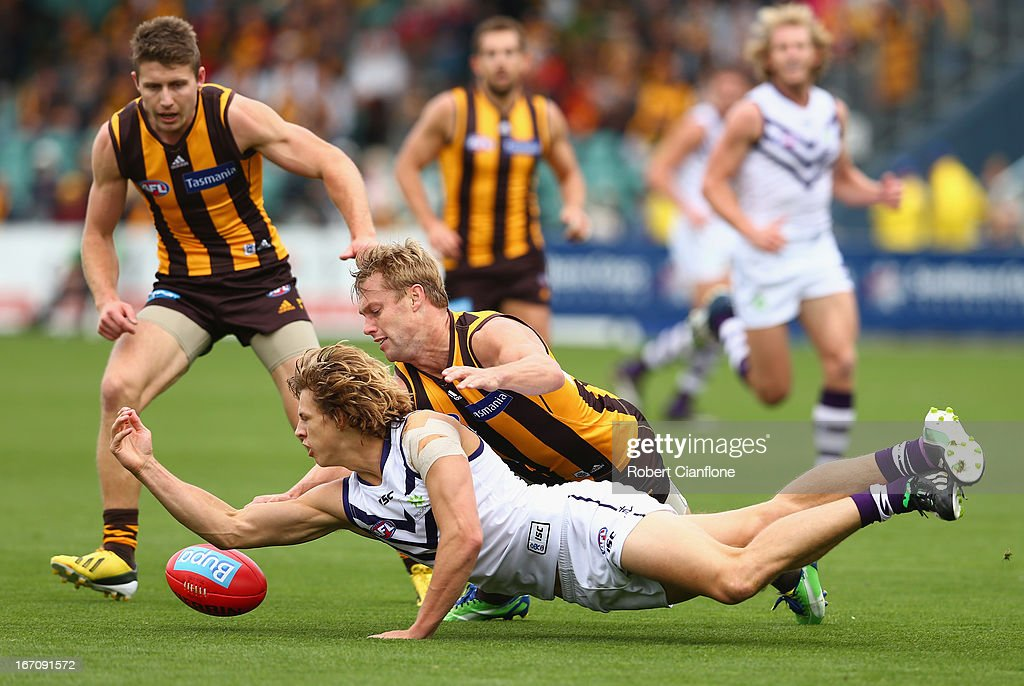 Nathan Fyfe of the Dockers is challenged by <a gi-track='captionPersonalityLinkClicked' href=/galleries/search?phrase=Sam+Mitchell+-+Australian+Rules+Football+Player&family=editorial&specificpeople=15086217 ng-click='$event.stopPropagation()'>Sam Mitchell</a> of the Hawks during the round four AFL match between the Hawthorn Hawks and the Fremantle Dockers at Aurora Stadium on April 20, 2013 in Launceston, Australia.