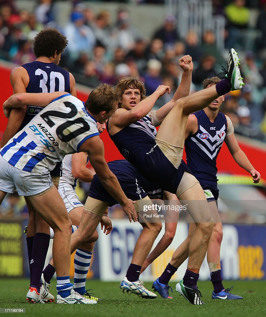 Nathan Fyfe of the Dockers kicks ball forward during the round 13 AFL match between the Fremantle Dockers and the North Melbourne Kangaroos at Patersons Stadium on June 23, 2013 in Perth, Australia.