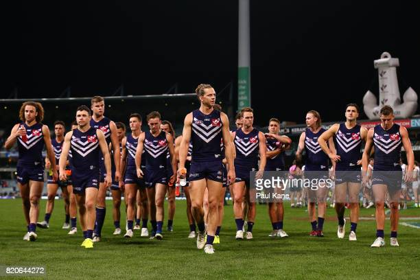 Nathan Fyfe of the Dockers leads his team from the field after being defeate during the round 18 AFL match between the Fremantle Dockers and the...