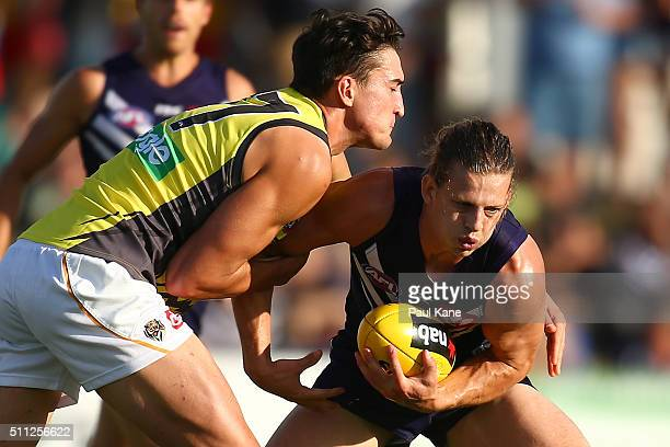 Nathan Fyfe of the Dockers looks to break from a tackle by Ivan Soldo of the Tigers during the 2016 AFL NAB Challenge match between the Fremantle...