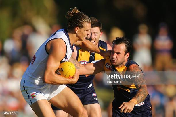 Nathan Fyfe of the Dockers looks to fend off a tackle by Chris Masten of the Eagles during the JLT Community Series AFL match between the West Coast...