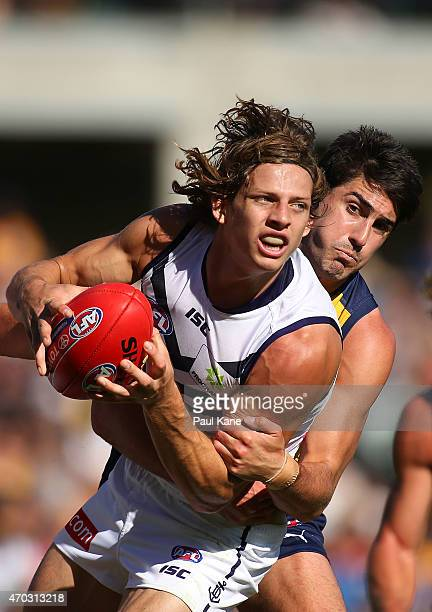 Nathan Fyfe of the Dockers looks to handball while being tackled by Matt Rosa of the Eagles during the round three AFL match between the West Coast...