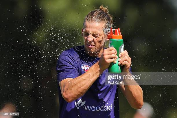 Nathan Fyfe of the Dockers sprays water from a drink bottle to cool down as players warm up before the JLT Community Series AFL match between the...