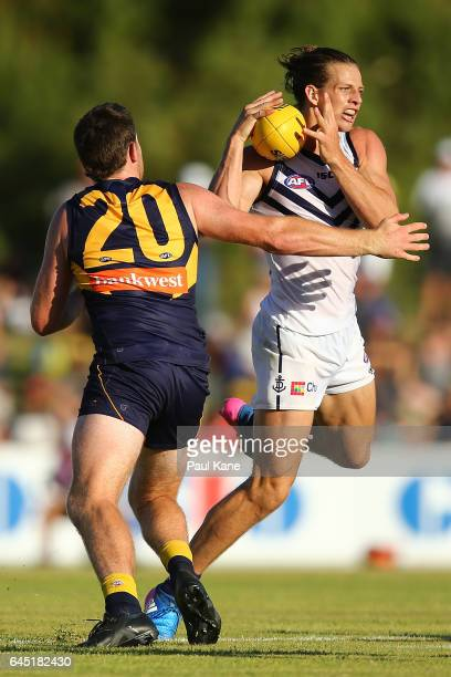Nathan Fyfe of the Dockers wins possession for the ball against Jeremy McGovern of the Eagles during the JLT Community Series AFL match between the...