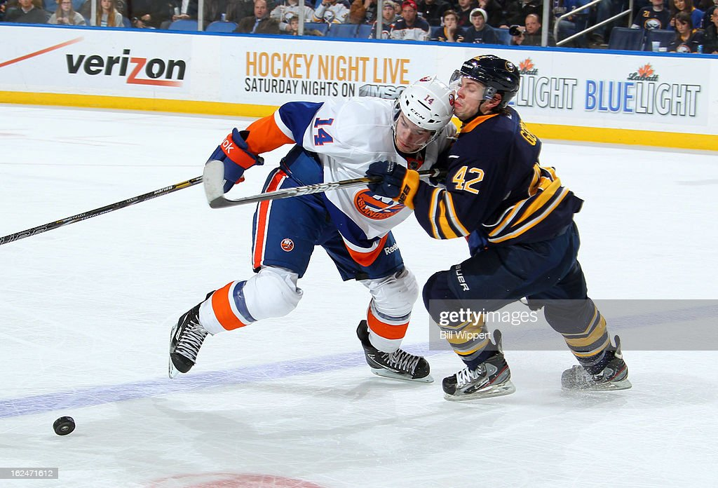 <a gi-track='captionPersonalityLinkClicked' href=/galleries/search?phrase=Nathan+Gerbe&family=editorial&specificpeople=697084 ng-click='$event.stopPropagation()'>Nathan Gerbe</a> #42 of the Buffalo Sabres battles for the puck against Thomas Hickey #14 of the New York Islanders on February 23, 2013 at the First Niagara Center in Buffalo, New York.