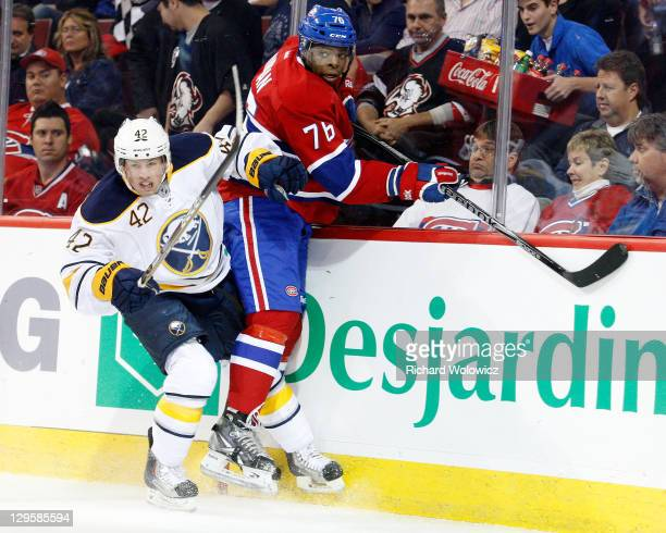 Nathan Gerbe of the Buffalo Sabres body checks PK Subban of the Montreal Canadiens during the NHL game at the Bell Centre on October 18 2011 in...
