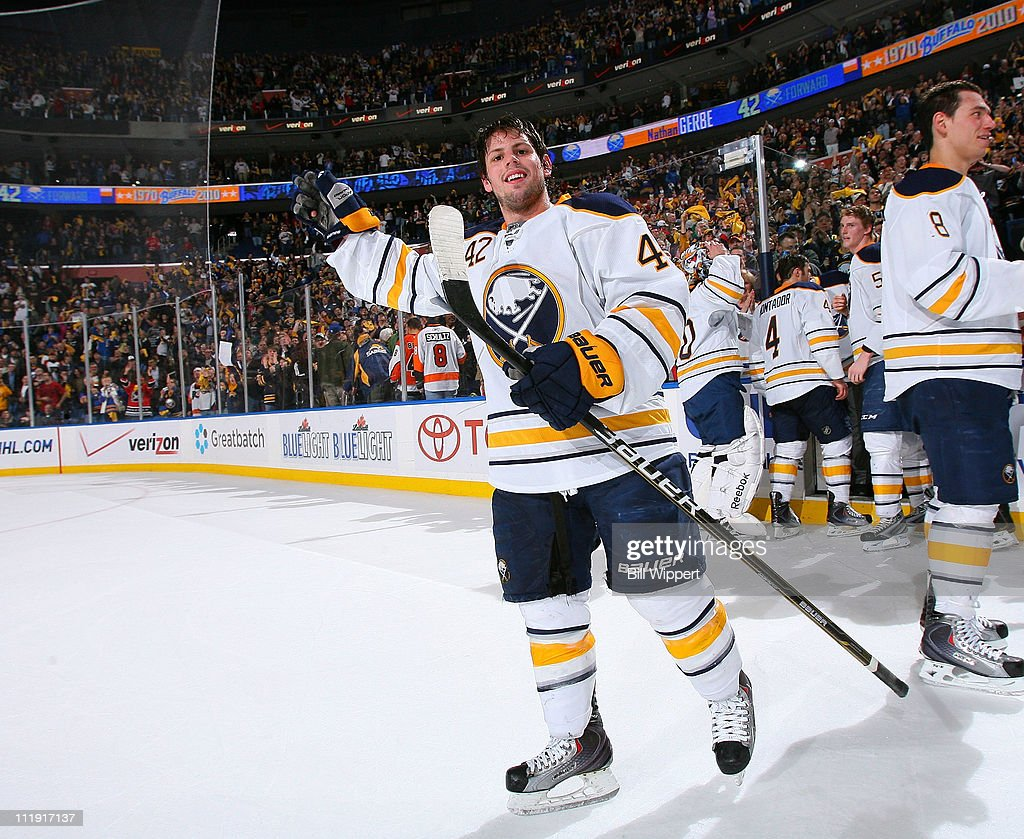 Nathan Gerbe #42 of the Buffalo Sabres celebrates an overtime win against the Philadelphia Flyers at HSBC Arena on March 8, 2011 in Buffalo, New York, securing the Sabres a spot in the playoffs.