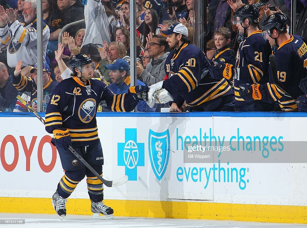 Nathan Gerbe #42 of the Buffalo Sabres celebrates his goal with Ryan Miller #30 against the New York Rangers on April 19, 2013 at the First Niagara Center in Buffalo, New York.