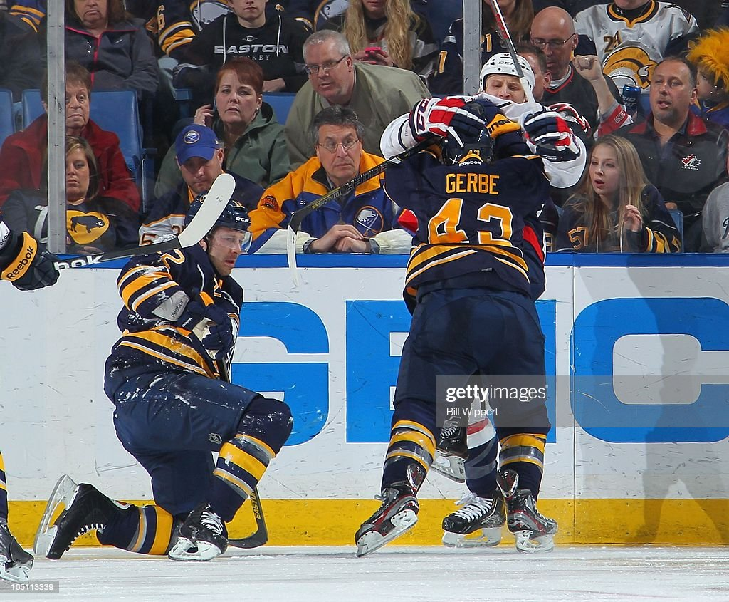 <a gi-track='captionPersonalityLinkClicked' href=/galleries/search?phrase=Nathan+Gerbe&family=editorial&specificpeople=697084 ng-click='$event.stopPropagation()'>Nathan Gerbe</a> #42 of the Buffalo Sabres challenges Steve Oleksy #61 of the Washington Capitals after teammate Kevin Porter #12 was checked by Oleksy on March 30, 2013 at the First Niagara Center in Buffalo, New York.