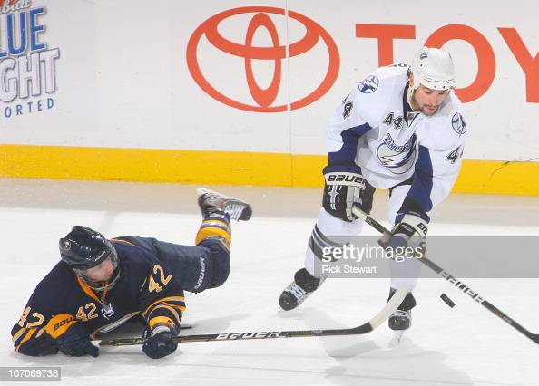Nathan Gerbe of the Buffalo Sabres falls as he defends against Nate Thompson of the Tampa Bay Lightning at HSBC Arena on November 20 2010 in Buffalo...