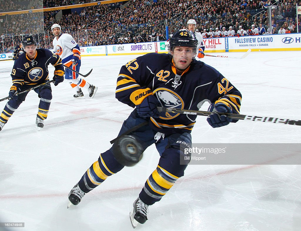 <a gi-track='captionPersonalityLinkClicked' href=/galleries/search?phrase=Nathan+Gerbe&family=editorial&specificpeople=697084 ng-click='$event.stopPropagation()'>Nathan Gerbe</a> #42 of the Buffalo Sabres follows the puck against the New York Islanders on February 23, 2013 at the First Niagara Center in Buffalo, New York.
