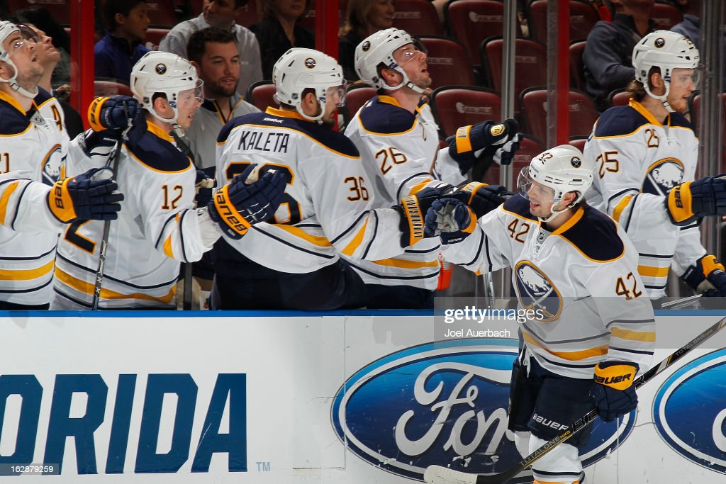 Nathan Gerbe #42 of the Buffalo Sabres is congratulated by teammates after scoring the first goal of the game against the Florida Panthers at the BB&T Center on February 28, 2013 in Sunrise, Florida.