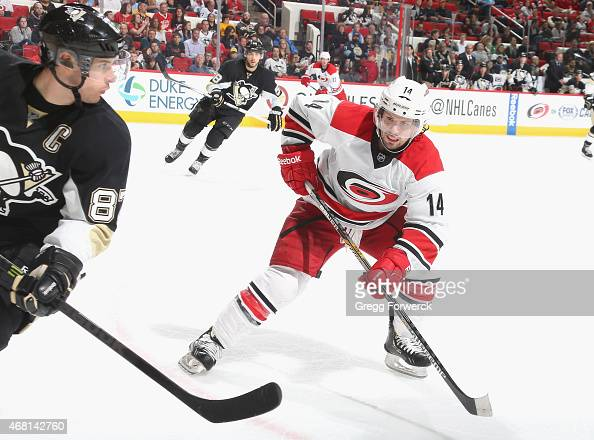 Nathan Gerbe of the Carolina Hurricanes defends near the corner as Sidney Crosby of the Pittsburgh Penguins attempts to gain control of a loose puck...