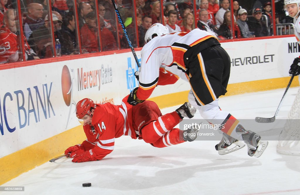 Nathan Gerbe of the Carolina Hurricanes goes down behind the net while battling against Ladislav Smid of the Calgary Flames during their NHL game at...