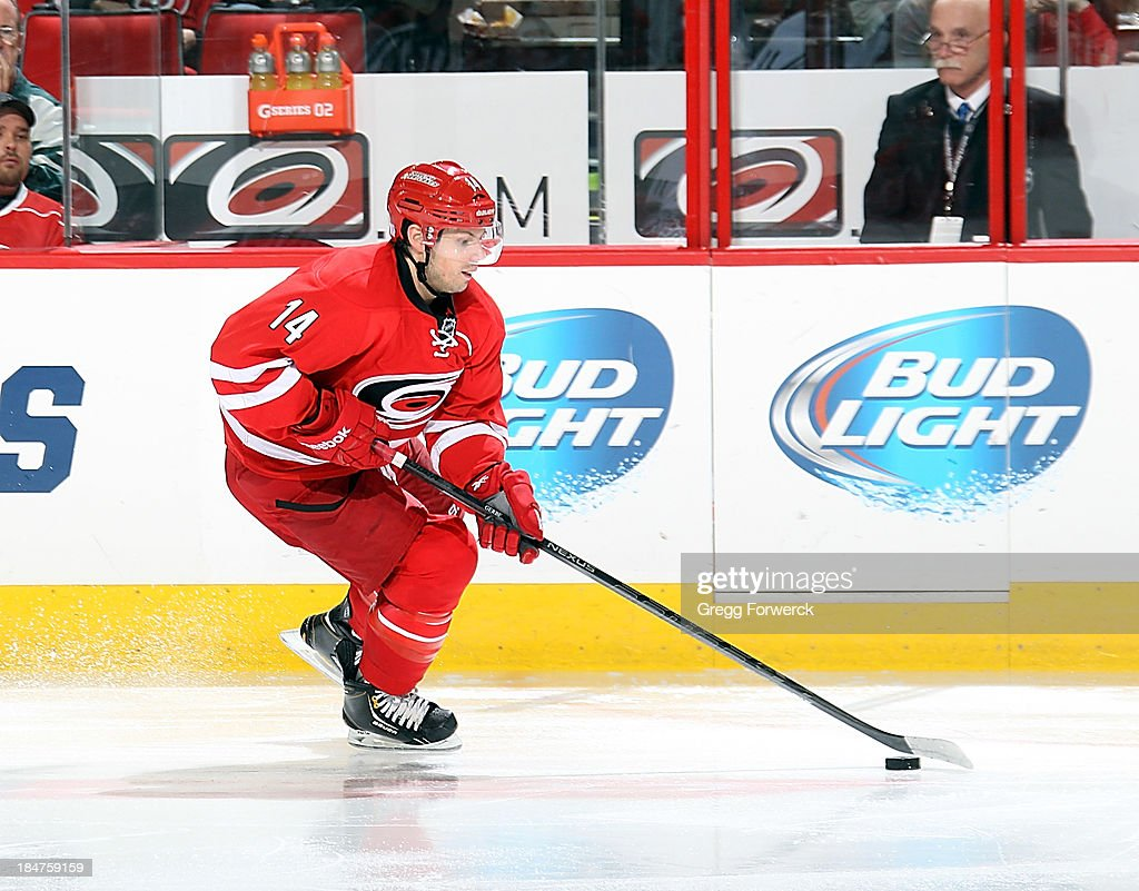 <a gi-track='captionPersonalityLinkClicked' href=/galleries/search?phrase=Nathan+Gerbe&family=editorial&specificpeople=697084 ng-click='$event.stopPropagation()'>Nathan Gerbe</a> #14 of the Carolina Hurricanes skates with the puck against the Los Angeles Kings during an NHL game on October 11, 2013 at PNC Arena in Raleigh, North Carolina.