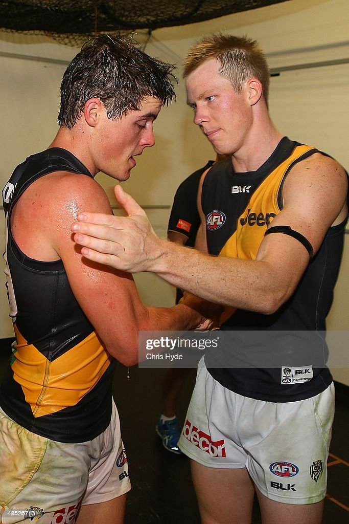 Nathan Gordon and <a gi-track='captionPersonalityLinkClicked' href=/galleries/search?phrase=Jack+Riewoldt&family=editorial&specificpeople=2327975 ng-click='$event.stopPropagation()'>Jack Riewoldt</a> of th Tigers celebrate winning the round five AFL match between the Brisbane Lions and the Richmond Tigers at The Gabba on April 17, 2014 in Brisbane, Australia.