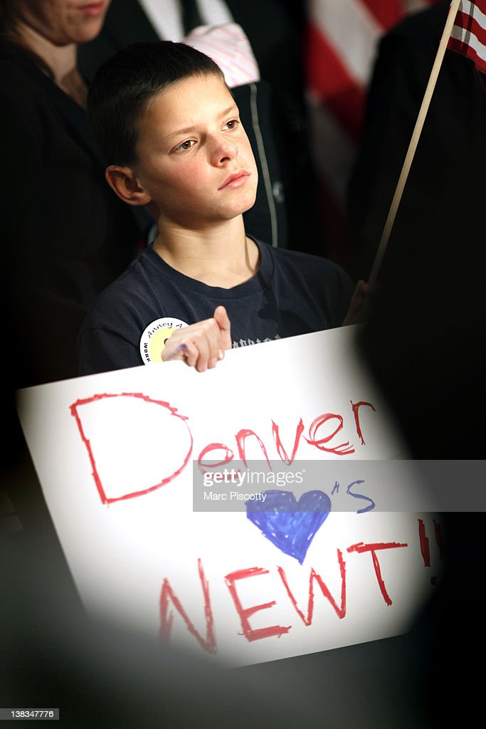 Nathan Gray, 10, of Mead, Colorado holds a sign in support of Republican presidential candidate, former Speaker of the House Newt Gingrich during a campaign rally at the Marriott Denver West February 6, 2012 in Golden, Colorado. Gingrich is visiting Colorado to meet supporters and share his solutions for creating jobs, balancing the budget and paying down our national debt in advance of Tuesday's Republican Caucuses in the state.