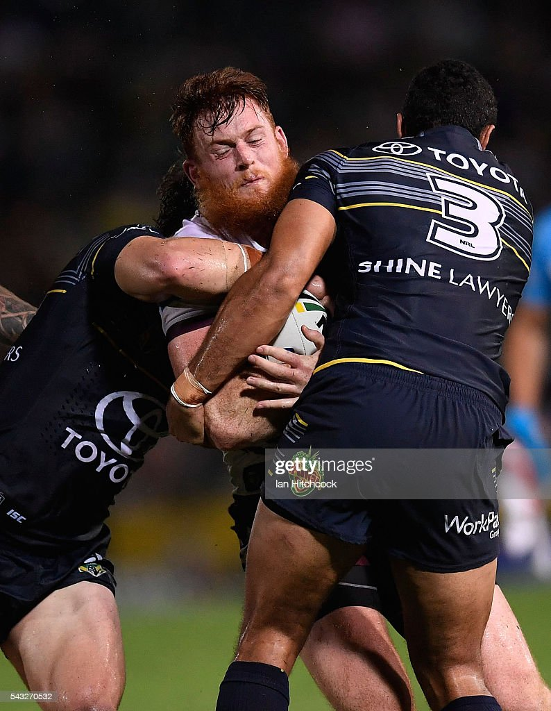 Nathan Green of the Sea Eagles is tackled by Justin O'Neil of the Cowboys during the round 16 NRL match between the North Queensland Cowboys and the Manly Sea Eagles at 1300SMILES Stadium on June 27, 2016 in Townsville, Australia.