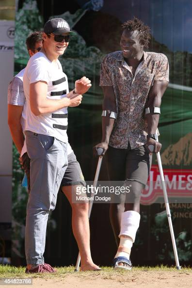Nathan Grima and Majak Daw of the Kangaroos watch on during the VFL Semi Final match between Williamstown and Werribee at North Port Oval on...