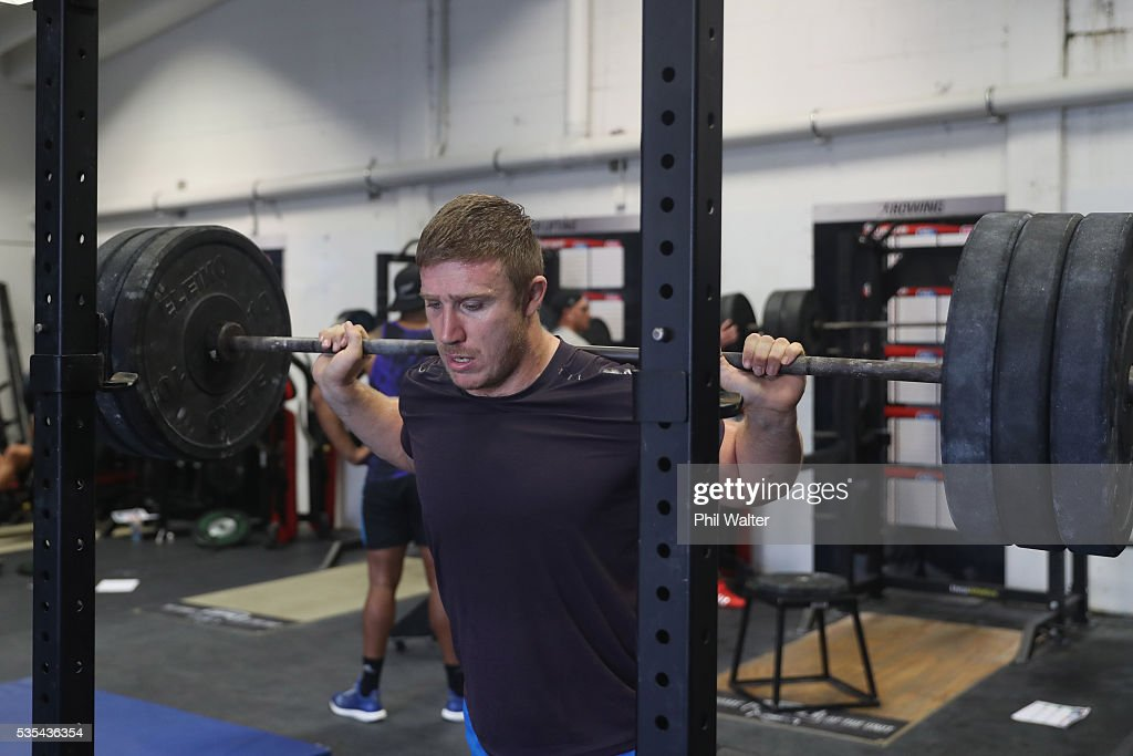 Nathan Harris of the All Blacks squats during a gym session at Les Mills on May 30, 2016 in Auckland, New Zealand.
