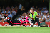 Nathan Hauritz of the Thunder attempts to run out Riki Wessels of the Sixers during the Big Bash League match between the Sydney Sixers and the...
