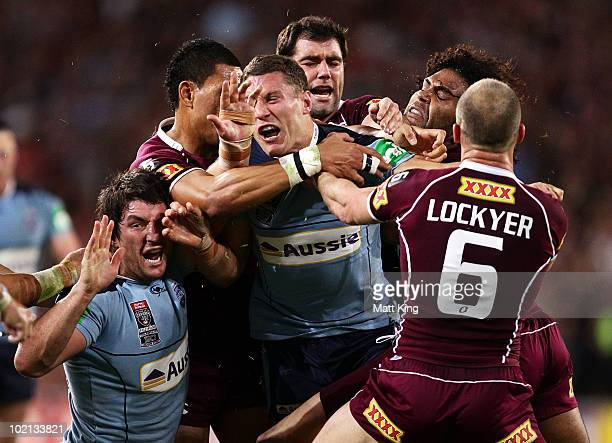 Nathan Hindmarsh and Luke O'Donnell of the Blues are involved in a fight with Maroons players after a spear tackle on Darius Boyd of the Maroons...