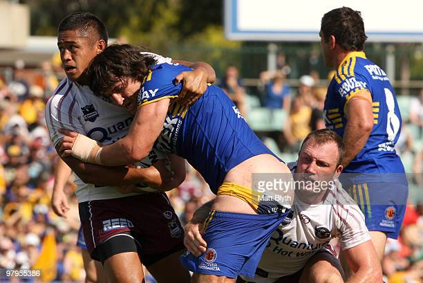 Nathan Hindmarsh of the Eels has his shorts pulled down in a tackle during the round two NRL match between the Parramatta Eels and the Manly Sea...