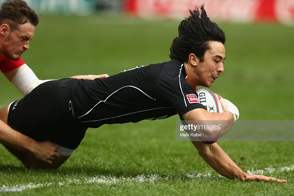 Nathan Hirayama of Canada dives over to score a try during the cup quarter final match between Wales and Canada day three of the 2013 Hong Kong Sevens at Hong Kong Stadium on March 24, 2013 in So Kon Po, Hong Kong.