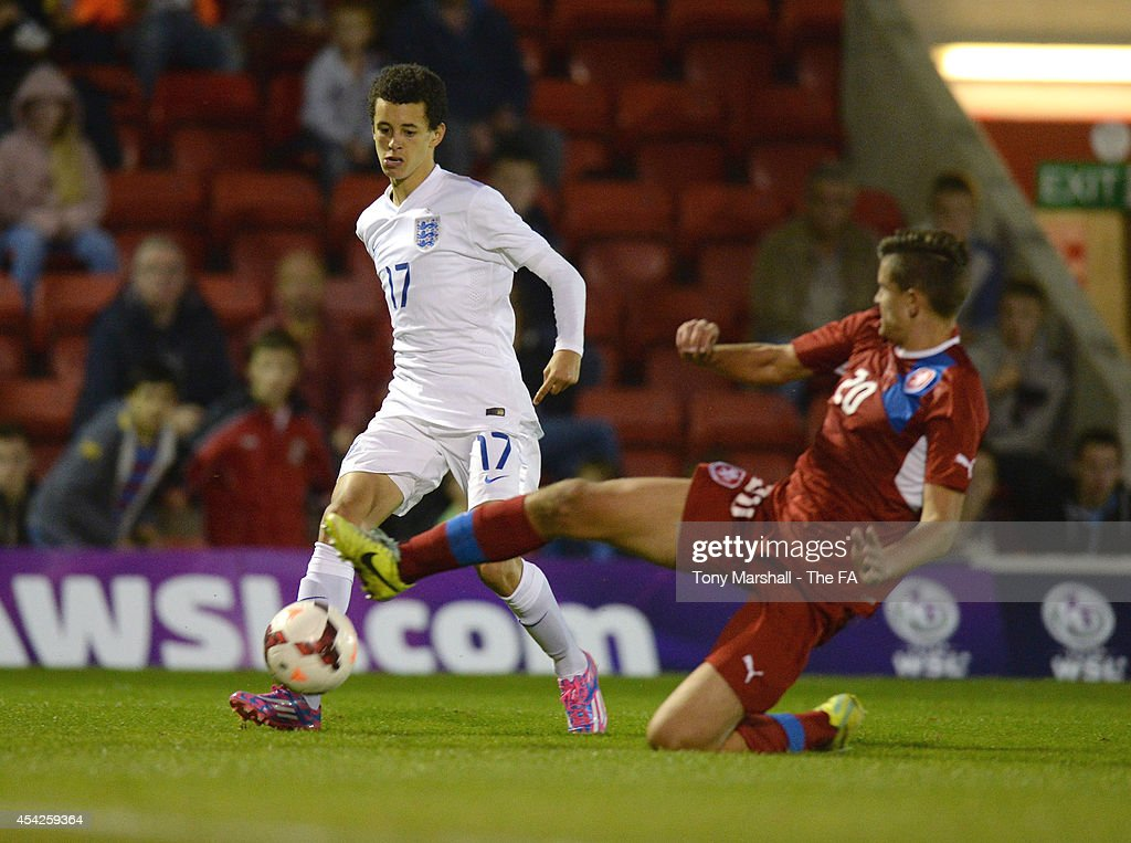 Nathan Holland of England tackled by Matej Chalus of Czech Republic during the Under 17 International match between England U17 and Czech Republic U17 at Aggborough Stadium on August 27, 2014 in Kidderminster, England.